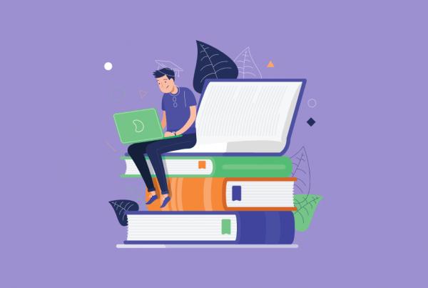 A imagem mostra um desenho de um homem estudando em seu notebook. Ele está sentado em uma pilha de livros.